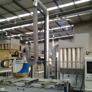 T750 dust collector installed on a CNC
